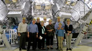 Lawrence Livermore National Laboratory Engineers Standing In Front Of A Nuclear Fusion Reactor