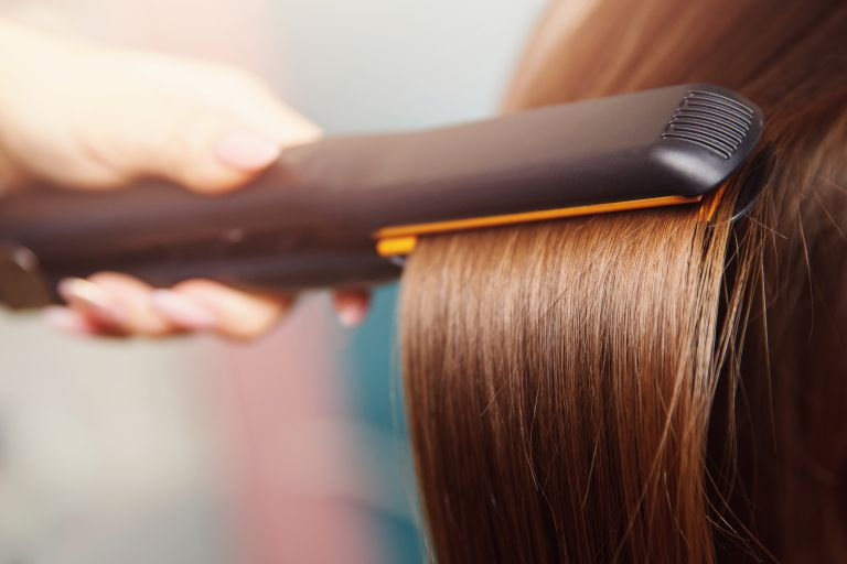 Best hair straightener: Hair straighteners being used on hair