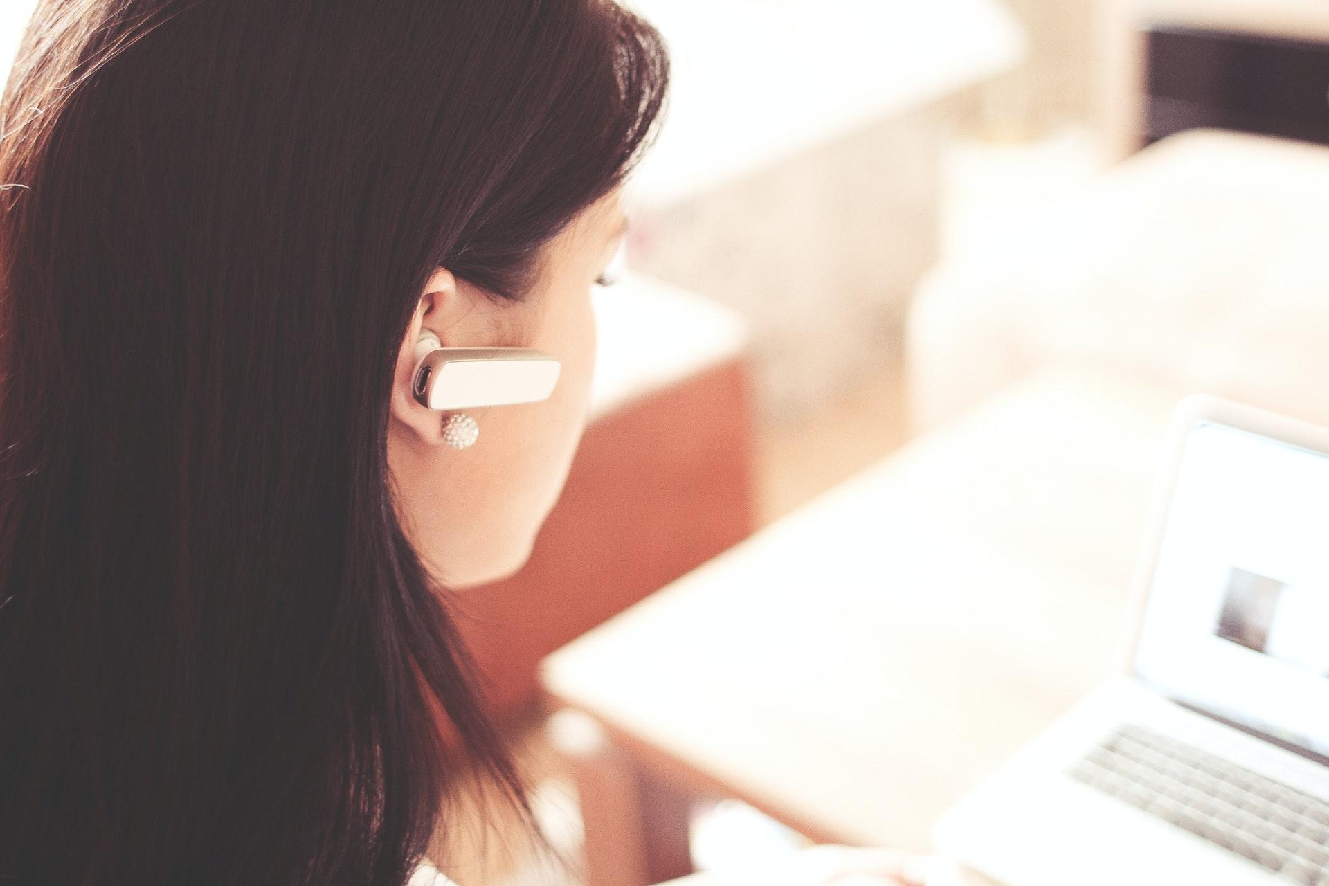 Customer support, woman wears earpiece