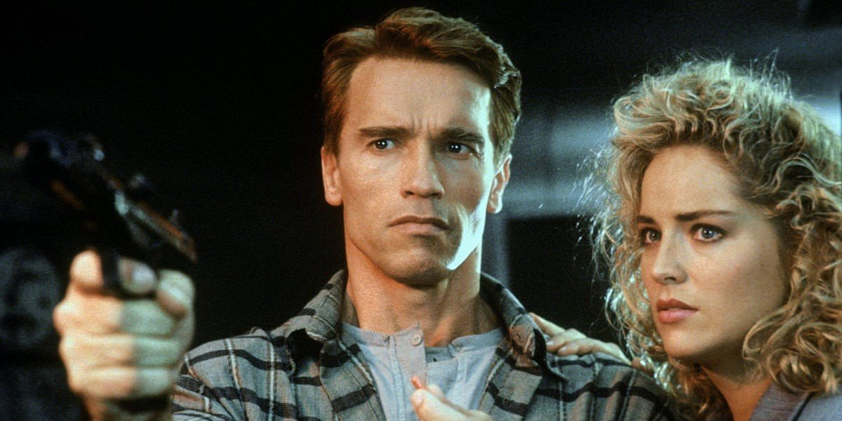 Arnold Schwarzenegger on the left, Sharon Stone on the right total recall