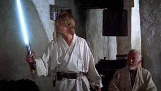 Luke Skywalker (Mark Hamill) holding a lightsaber in 1977's Star Wars