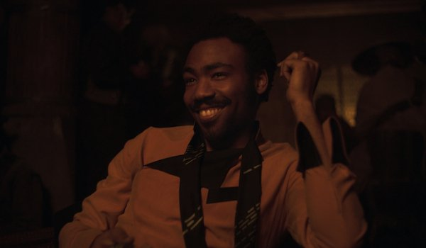 Solo: A Star Wars Story Lando smiling in the middle of a card game