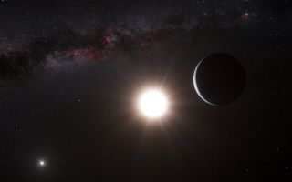 A planet looms next to a large and smaller star.