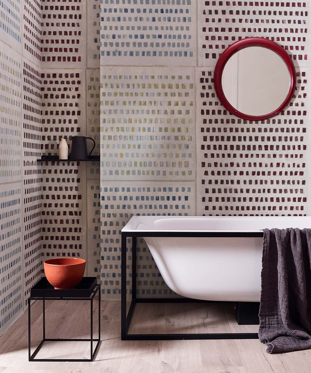Statement bathroom with dotty wallcovering | Homes & Gardens
