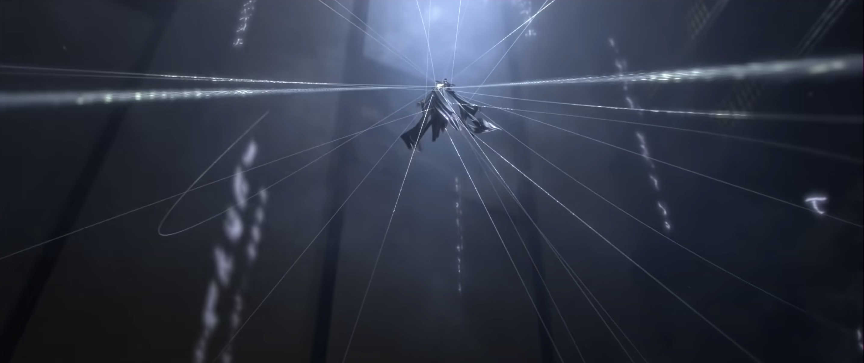 A screencap of an antagonist from the trailer. They've unleashed a web-like attack inside the opera house, and are suspended in the air with the webs surrounding them.