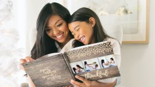 Woman and girl enjoying one of the best photo books