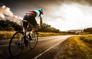 A cyclist rides his bike.