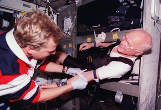 John Glenn in Discovery Bunk, 1998