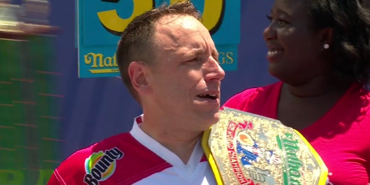 Joey Chestnut holding the Nathan's hot dog eating title ESPN