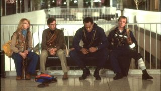 Four of the cast of Dawn of the Dead in a shopping mall.