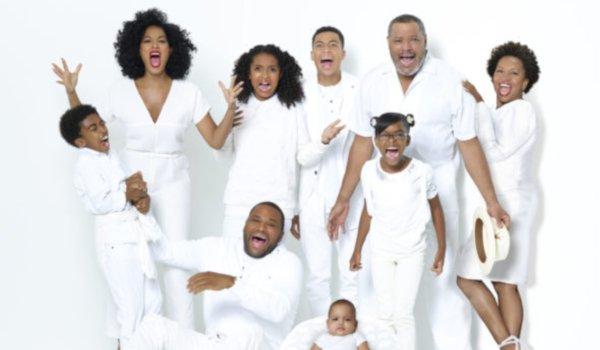 Black-ish the Johnson family smiling against a white background