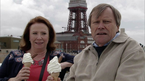 Cathy Matthews and Roy Cropper eat ice cream at the beach