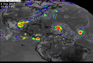 satellite images of 3 tropical storms brewing