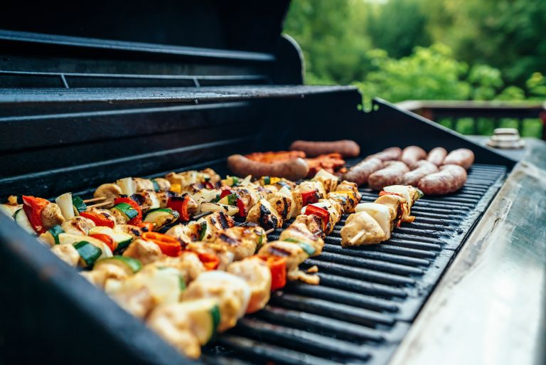 Grill with mixed foods on it