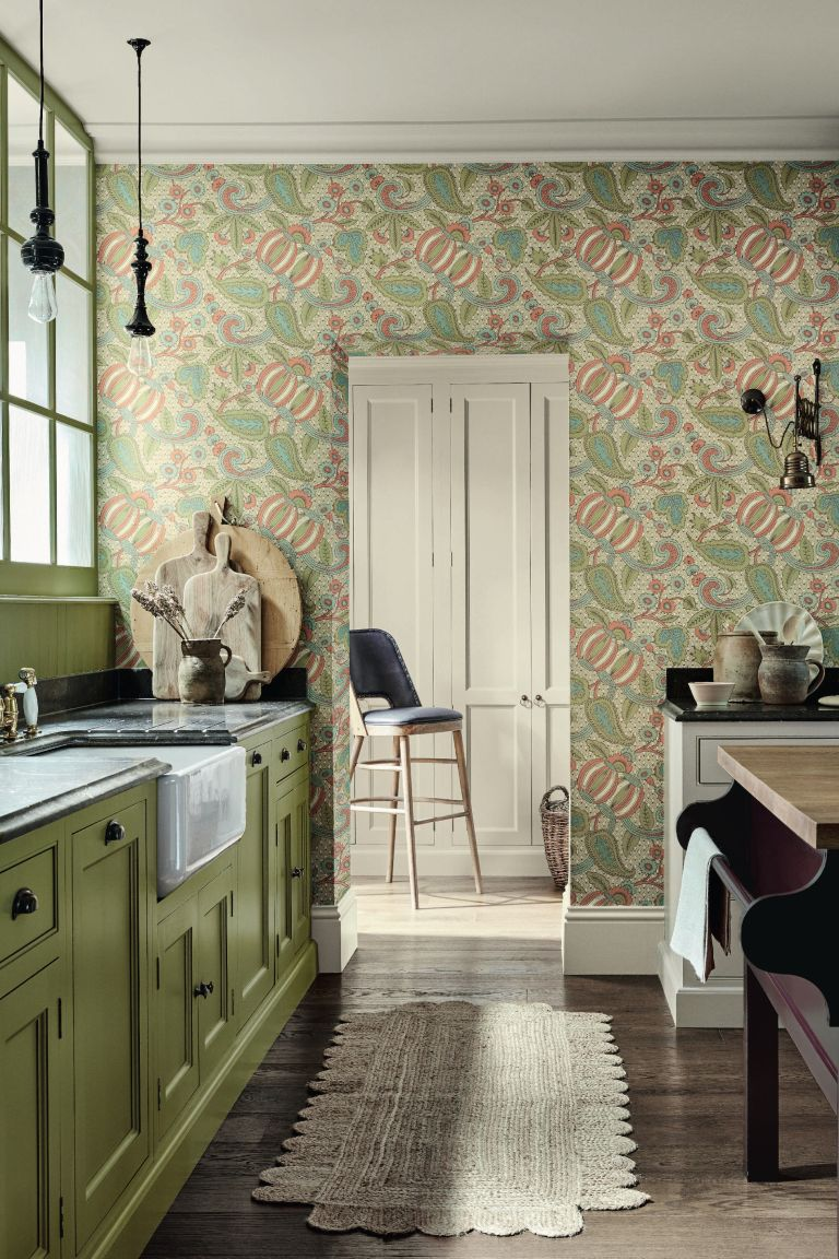 Kitchen with green floral wallpaper on far wall