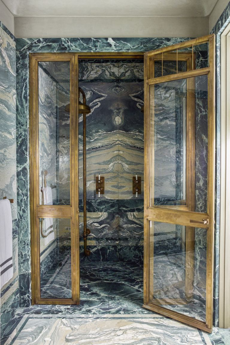 Shower room ideas illustrated by a dark marble Drummonds enclosure.