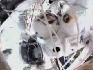 Astronauts Outfit Space Station in Mission's Last Spacewalk