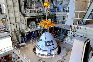 Boeing's CST-100 Starliner spacecraft was secured atop a United Launch Alliance Atlas V rocket at the Vertical Integration Facility at Space Launch Complex-41 at Florida's Cape Canaveral Space Force Station on July 17, 2021.