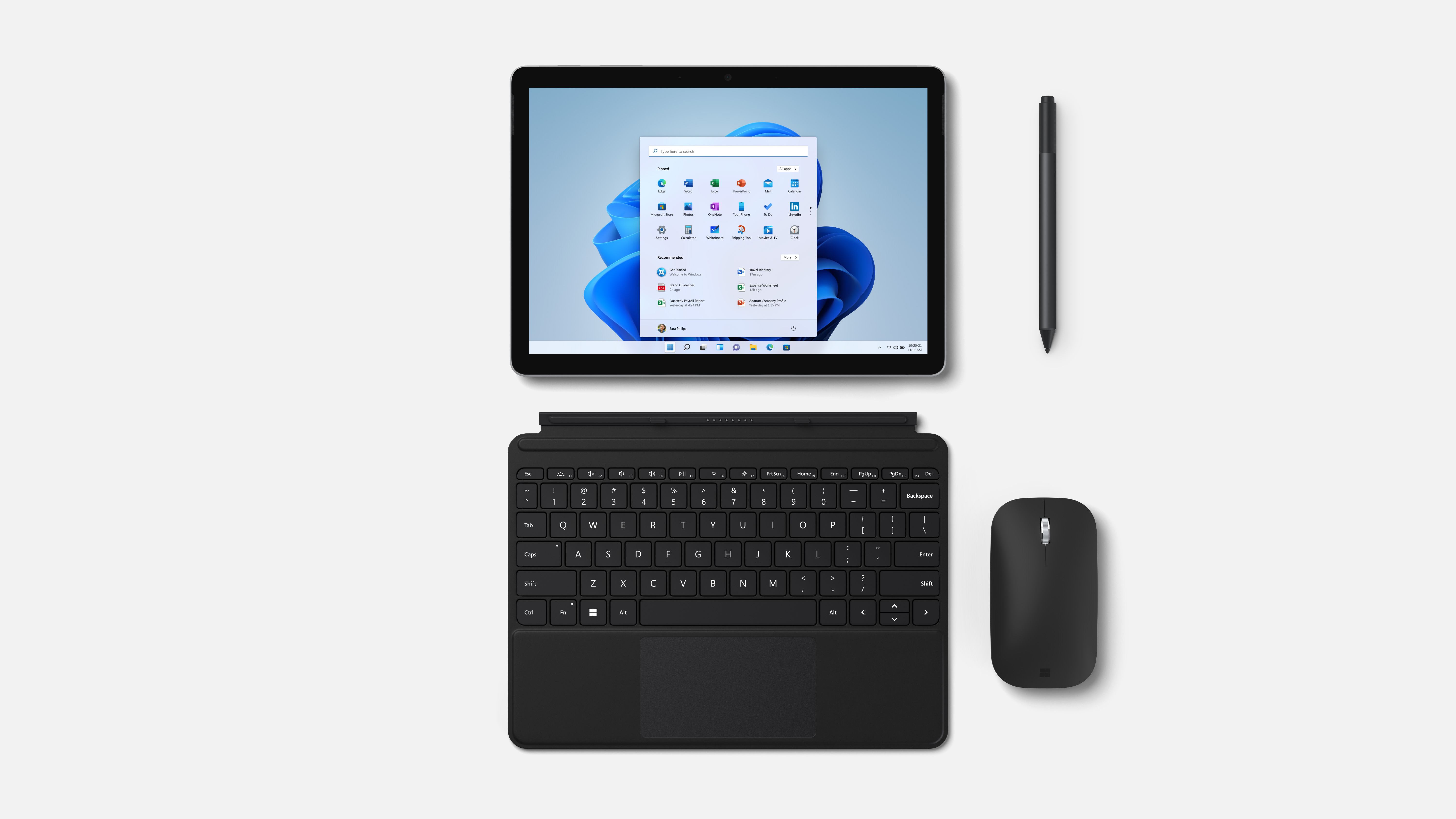 Microsoft Surface Pro 8 with detachable keyboard, stylus, and other accessories