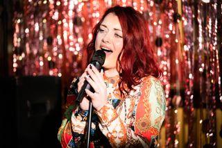EastEnders Whitney Dean sings on stage