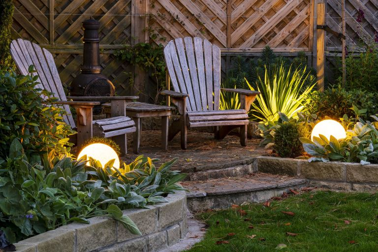 garden lighting ideas: Stone Globe Lights LEDs light up a seating area
