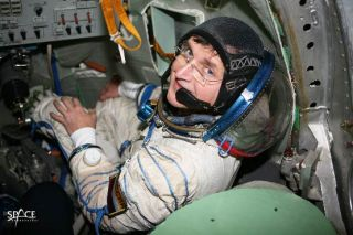 Space tourist Charles Simonyi trains inside a Soyuz spacecraft simulator before his first flight of April 2007. Simonyi launched on a second orbital mission in 2009, becoming the only two-time private space explorer.