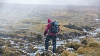 what to do if you get lost hiking: man in rainstorm