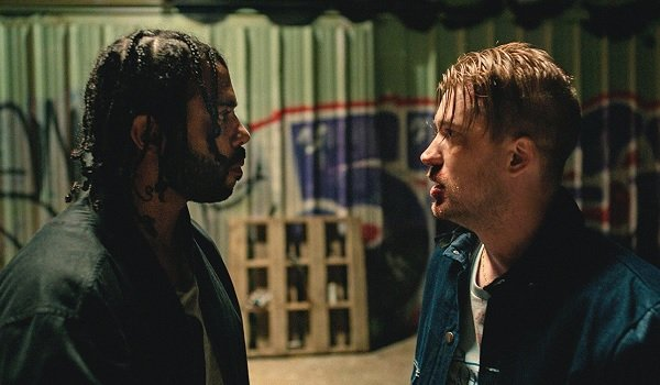 Blindspotting Daveed Diggs Rafael Casal frightened in an alley