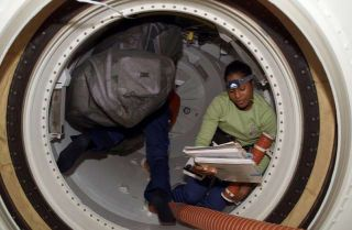Astronauts Haul Cargo, Prepare for Spacewalk