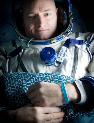 "Expedition 26 Commander Scott Kelly wears a blue wrist band that has a peace symbol, a heart and the word ""Gabby"" to show his love of his sister-in-law U.S. Rep. Gabrielle Giffords as he rest onboard a Russian Search and Rescue helicopter shortly after he"