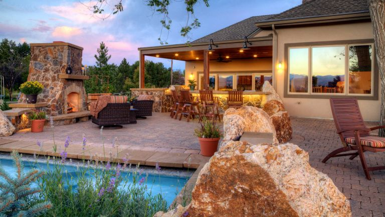 backyard landscaping ideas with paving and pool