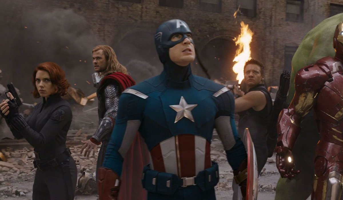 The Avengers Chris Evans stands in the center of the circle