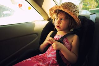 A young girl inside a car.