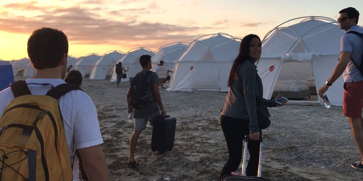 """Attendees arrive at their """"glamping"""" tents in Fyre: The Greatest Party That Never Happened"""