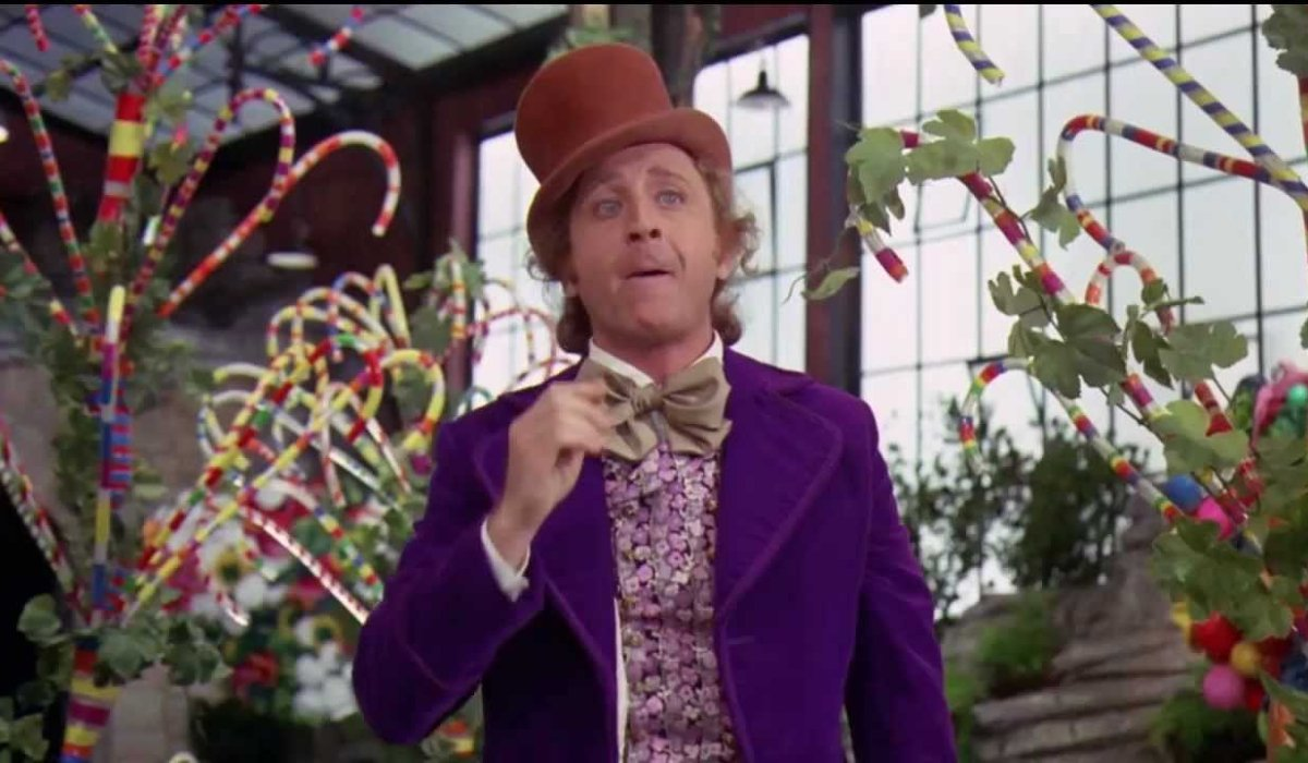 Willy Wonka and the Chocolate Factory Gene Wilder happily eats candy
