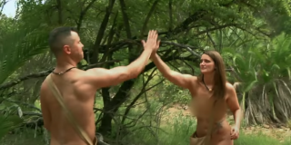 Two people high-five on Naked and Afraid