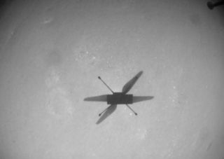 NASA's Mars helicopter Ingenuity sees its shadow on the Martian surface during its 10th flight on July 24, 2021.