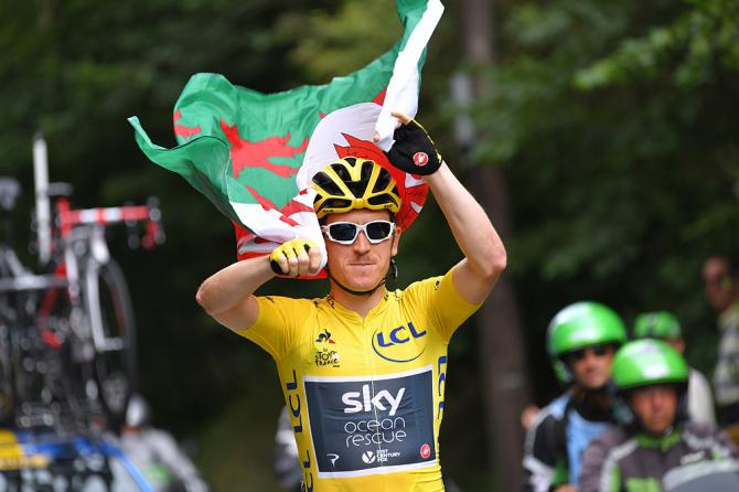 Geraint Thomas (Team Sky) carries the Welsh flag over his head during the last stage at the Tour de France