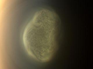 titan south pole strange vortex