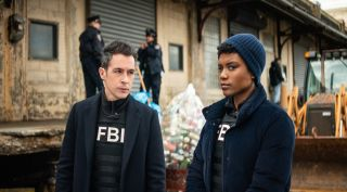 John Boyd as Special Agent Stuart Scola and Katherine Renee Turner as Special Agent Tiffany Wallace.