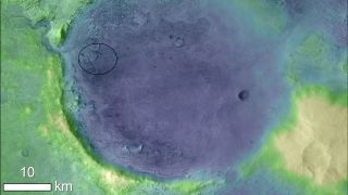 Lighter colors represent higher elevation in this image of Jezero Crater on Mars, the landing site for NASA's Mars 2020 mission. The oval indicates the landing ellipse, where the rover will be touching down on Mars.