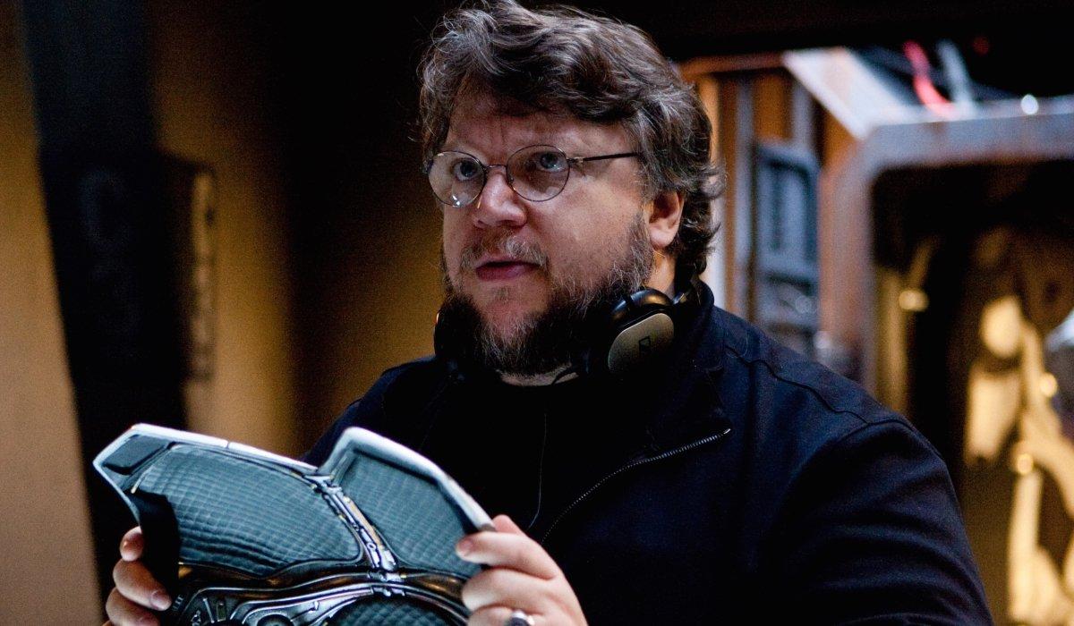 Pacific Rim Guillermo del Toro holding a breastplate of armor on set