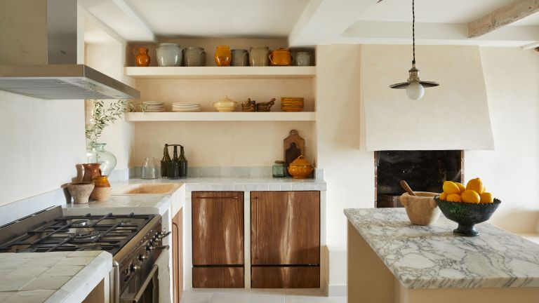 Rustic Provencal-style wooden kitchen in 16th century French townhouse in Saint-Paul de Vence