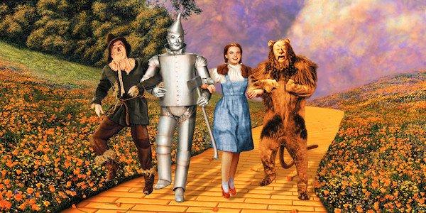 The Wizard of Oz Dorothy Scarecrow Lion Tin Man on yellow brick road