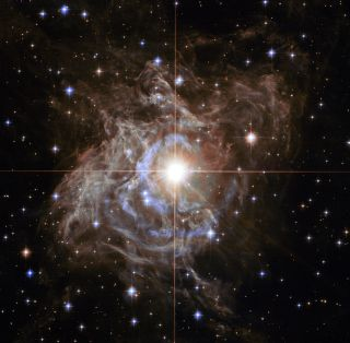 A Hubble Space Telescope image shows RS Puppis, one of the brightest Cepheids visible in our galaxy. Astrophysicists use stars like this to calculate the expansion rate of the universe.