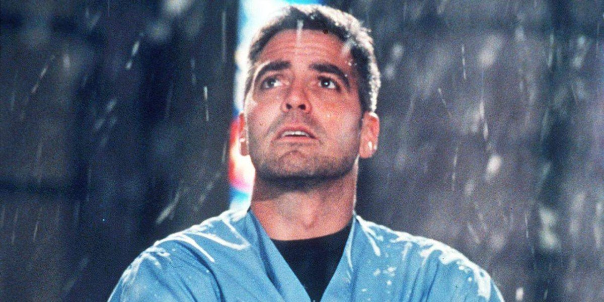 Doug Ross (George Clooney) stares into the sky as it rains in ER