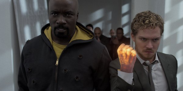 Luke Cage and Iron Fist in the hallway battle