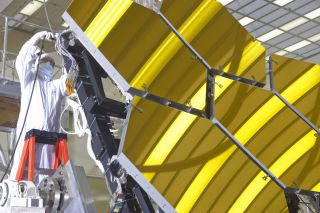 Technician on JWST mirrors