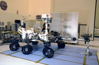NASA's Mars Science Laboratory (MSL), named Curiosity, as seen fully deployed on Friday, Aug. 12, 2011 during a media photo opportunity inside Kennedy Space Center's Kennedy's Payload Hazardous Servicing Facility in Florida.