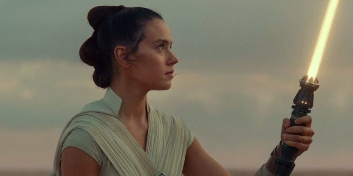 Rey with her yellow lightsaber